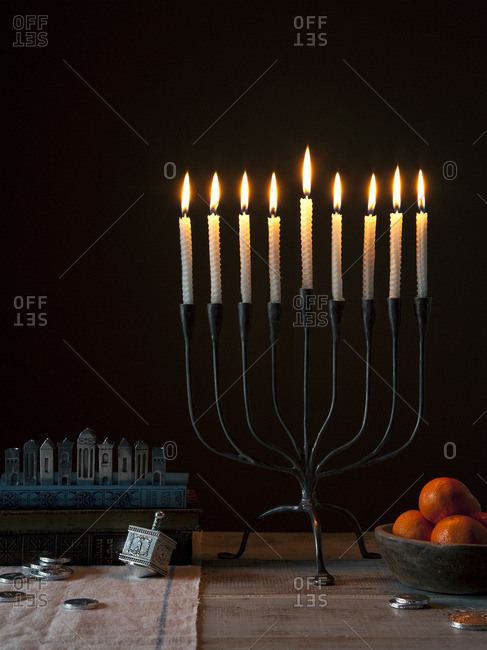 A menorah with candles lit