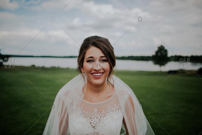Portrait of a smiling bride outdoors