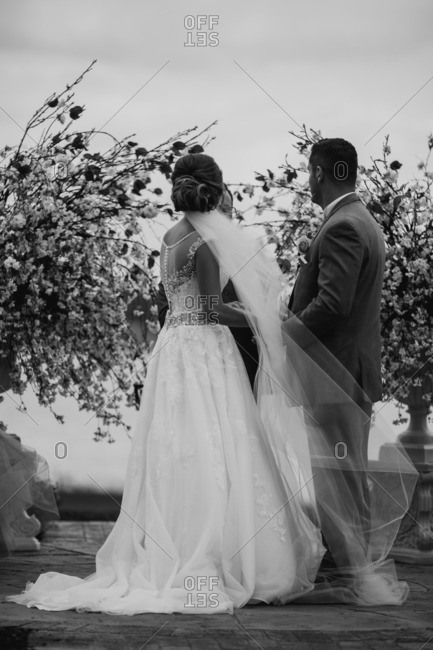 Bride and groom exchanging vows in black and white