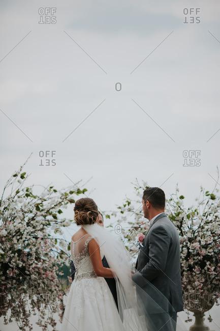 "Bride and groom saying ""I do"""