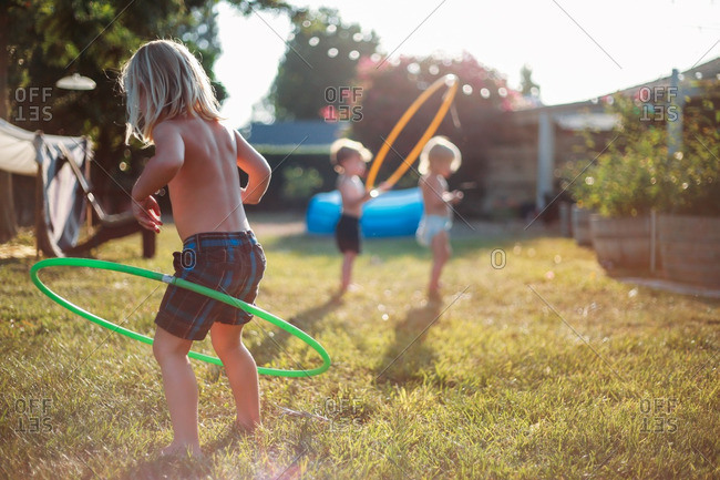 Children playing outside with hula hoops