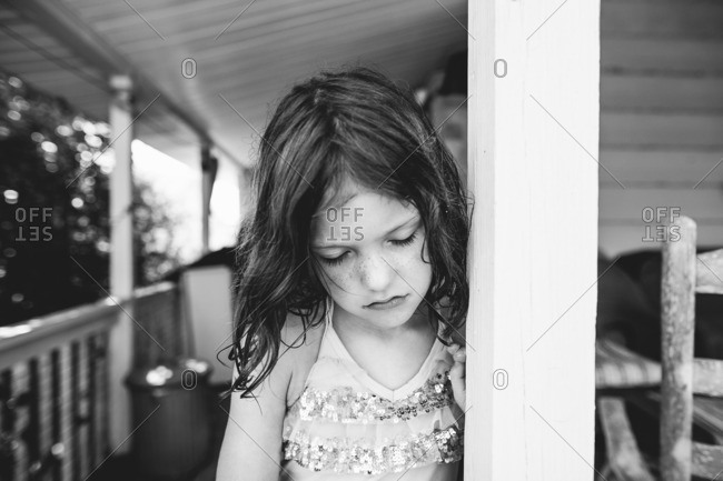 Close up of sad girl on a porch