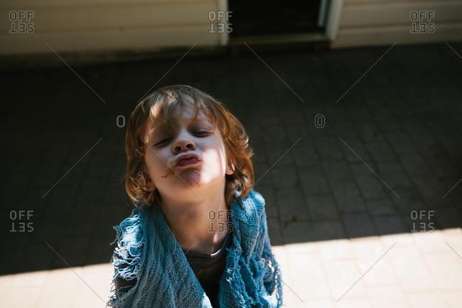 Redhead boy puckering his lips