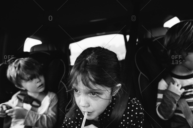 Children riding in back seat of a car