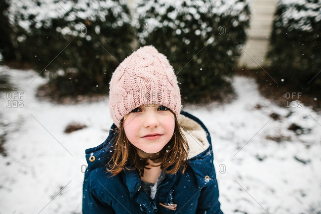 Children catching snowflakes on their tongues at night