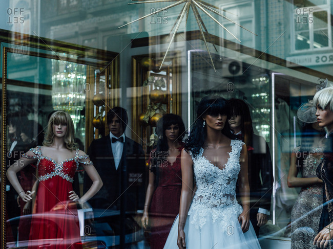 Store front with mannequins and fancy dresses