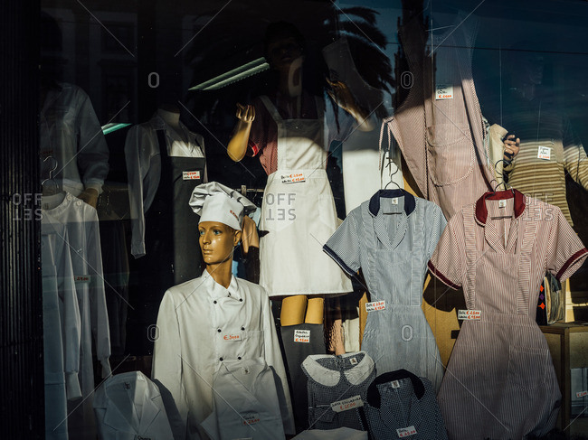 Porto, Portugal: Mannequins wearing uniforms in a storefront