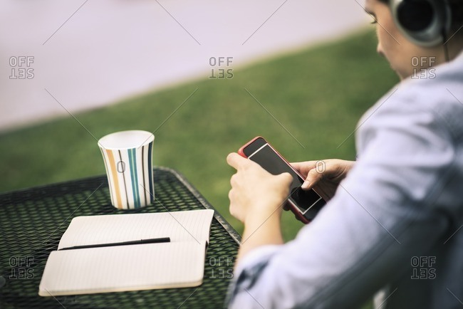 Woman listening to music while sitting outside