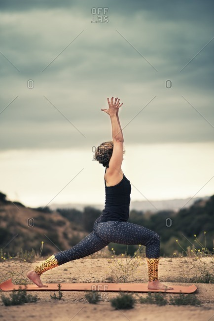 Woman practicing her yoga poses outdoors
