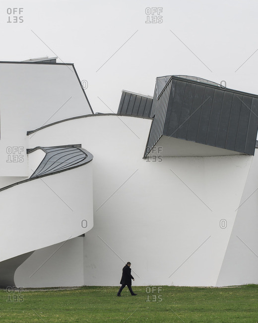 2/28/16: Man walking on grass next to Vitra Design Museum, Germany