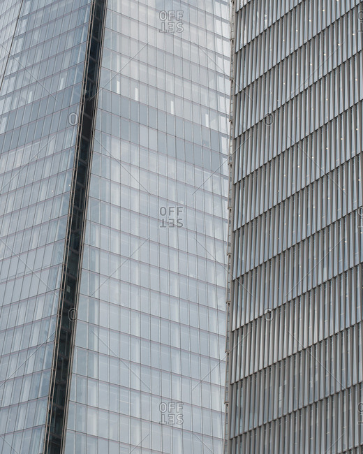 Abstracted view of two glass and steel skyscrapers