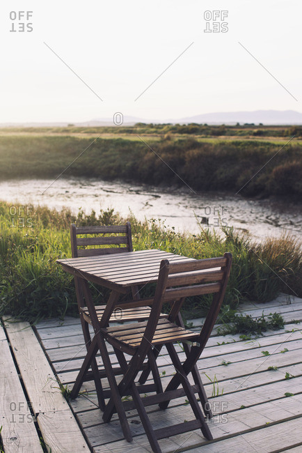 Wooden table and chairs on deck in
