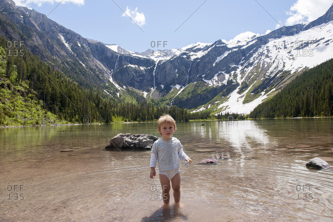 Child wading in water at Glacier National Park, Montana, USA
