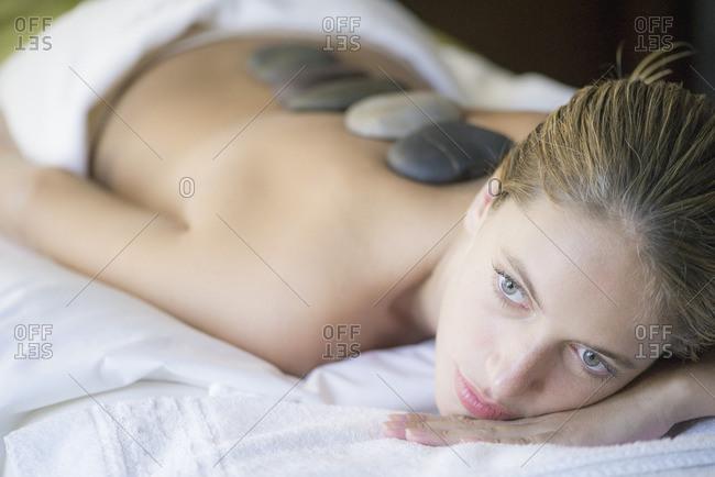 Woman getting lastone therapy
