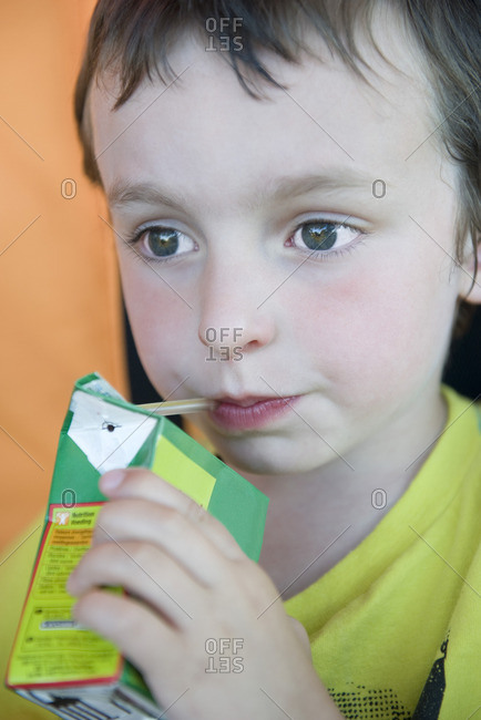 Little boy drinking juice box