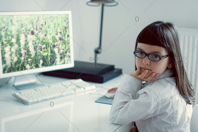 Girl sitting in front of desktop computer