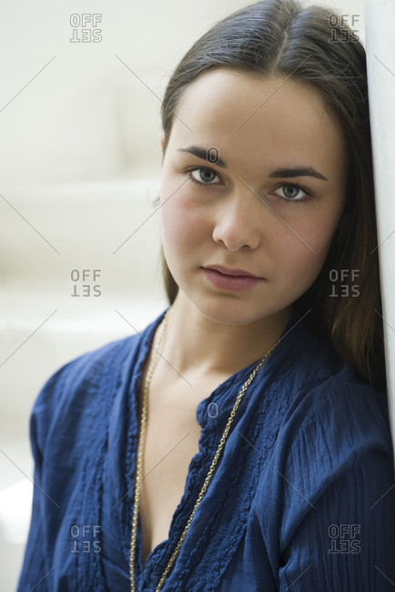 Young woman looking at camera, portrait