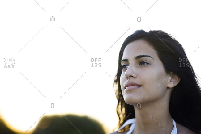 Young woman looking away contentedly, portrait