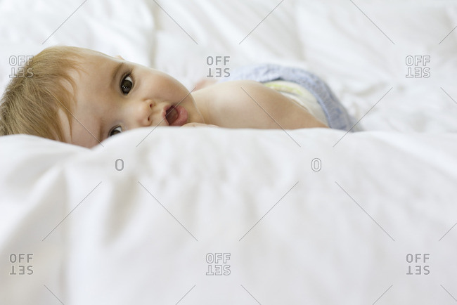 Baby lying on blanket, portrait