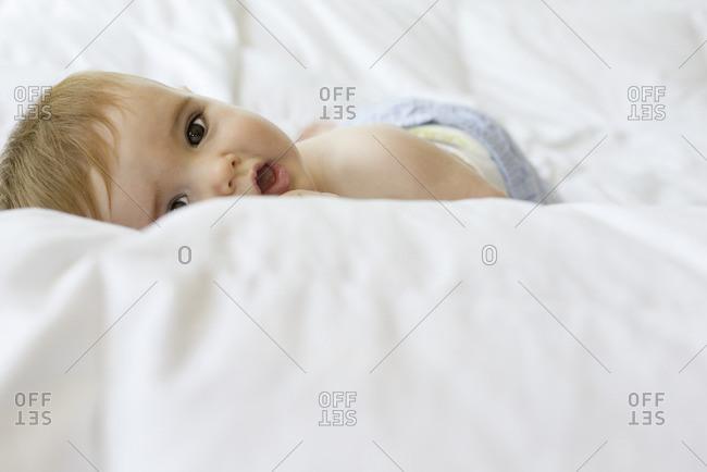 Baby lying on blanket, portrait