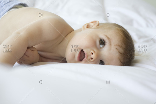 Baby lying on blanket, looking up
