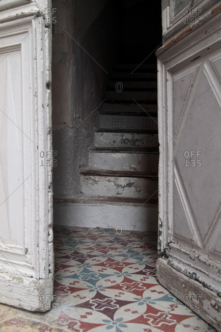 Half-open door leading to stairway