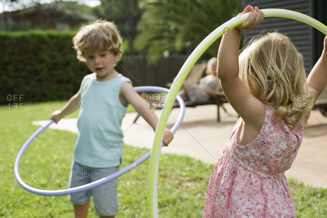Children playing with plastic hoops outdoors