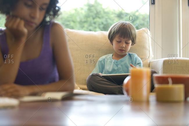 Boy reading e-book