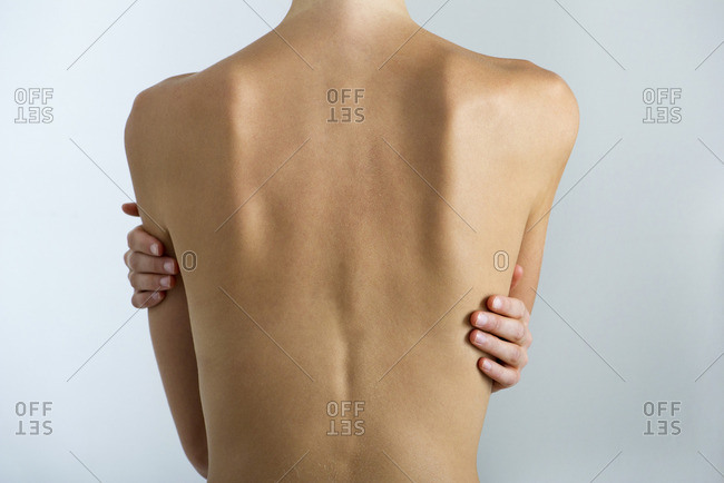Woman's naked back, mid section