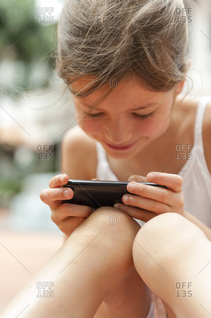 Girl playing with smartphone