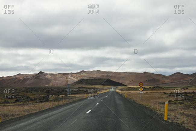 Road winding through barren landscape, Iceland