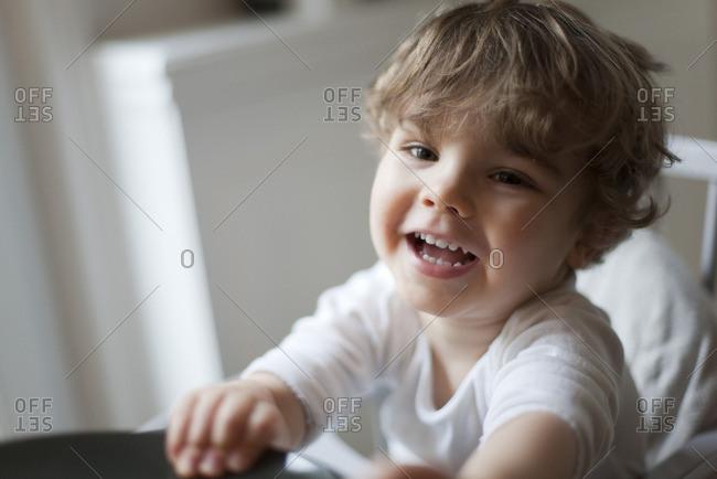 Toddler boy smiling, portrait - Offset