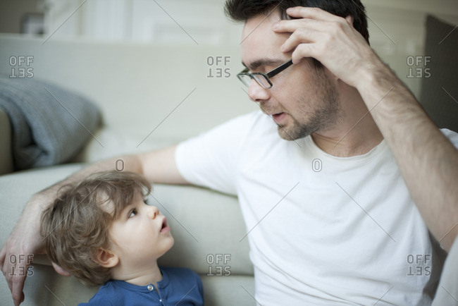 Father talking to young son, portrait