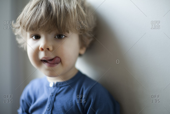 Little boy sticking out tongue, portrait