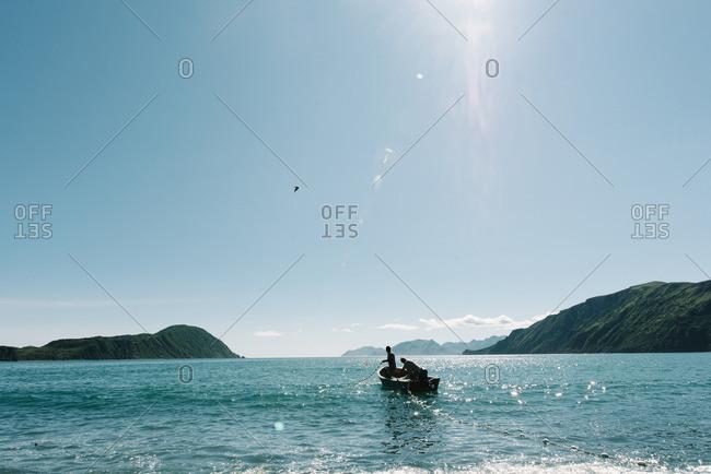 People fishing in the ocean