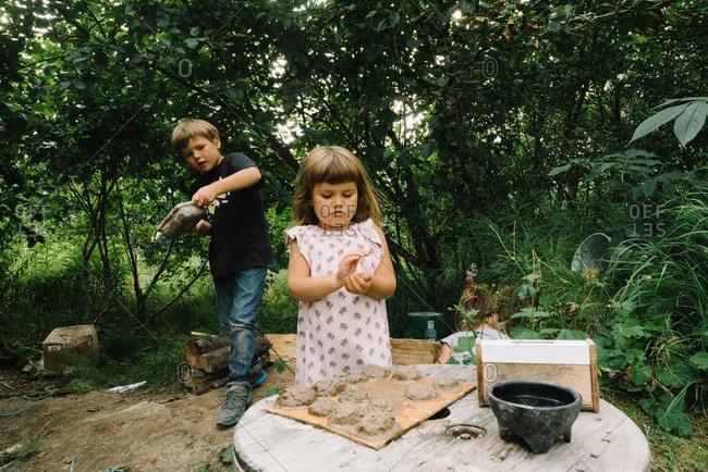Kids making mud pies in yard