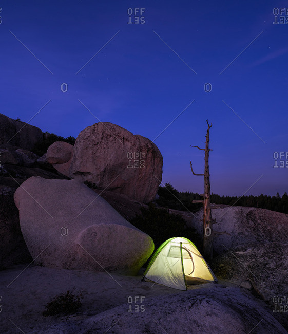 9/6/15: Tent on a barren, rocky landscape surrounded by granite boulders at night