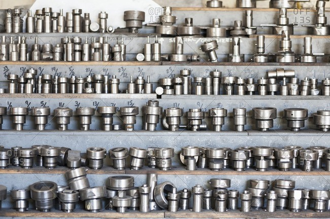 Variety of bolts on shelves in factory