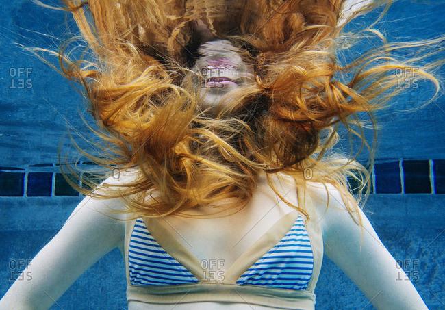 Caucasian woman underwater in swimming pool