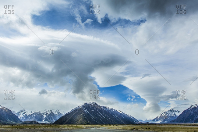 Cloudy sky over mountains and remote landscape