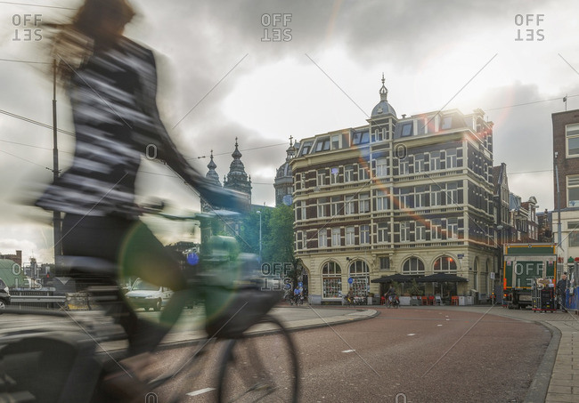 Amsterdam, Netherlands - September 3, 2013: Blurred bicyclist on city street