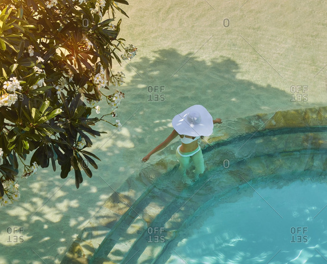 High angle view of Pacific Islander woman in swimming pool