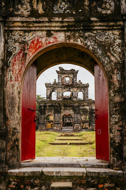Ornate archway in dilapidated ruins