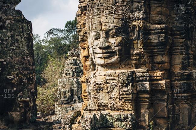Dilapidated statue and pillar at Angkor Wat, Siem Reap, Cambodia