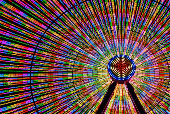 Spinning ferris wheel illuminated at night