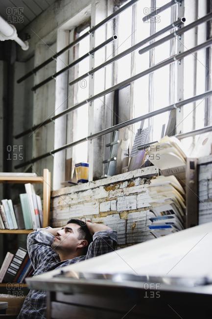 Hispanic man in workshop