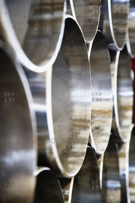 Close up of stacks of steel pipes