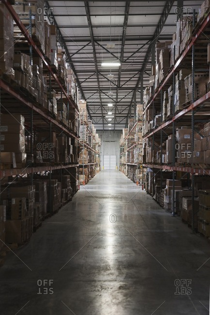 Boxes on shelves in warehouse