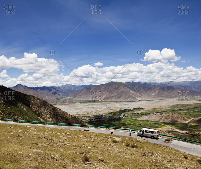 Road and remote valley with mountains in the distance