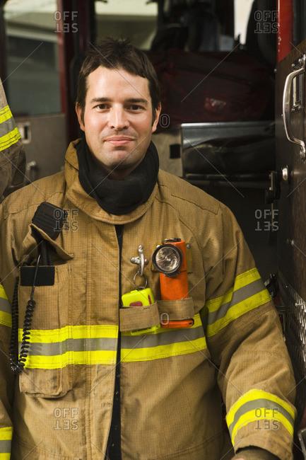 Hispanic fireman in coat